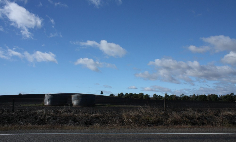 Water tanks in a burnt field, Cowra-Boorowa Road, 9 April 2012
